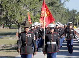 Drill Instructors and Marines with November Company, 4th Recruit Training Battalion march towards the Peatross Parade Deck before their graduation ceremony Nov. 16, 2018 at Marine Corps Recruit Depot Parris Island, S.C.