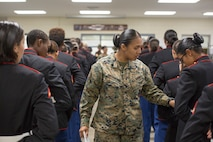 Sgt. Cristal Abregomedina, a warehouse clerk with Headquarters and Service Battalion, examines the uniforms of Marines from November Company, 4th Recruit Training Battalion Nov. 9, 2018 at Marine Corps Recruit Depot Parris Island, S.C.