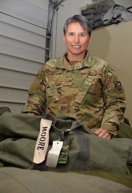 Master Sgt. Kerrie Moore, an airspace manager with the 193rd Combat Operations Squadron, prepares her mobility bag Oct. 19, 2018, in anticipation of another deployment.  Moore earned the title of 2017 Outstanding Senior Non-Commissioned Officer of the Year for the Pennsylvania National Guard. She was also named USO Air Force Servicemember of the Year for the Pennsylvania and Southern New Jersey region. (U.S. Air National Guard photo by 1st Lt. Susan Penning/Released)