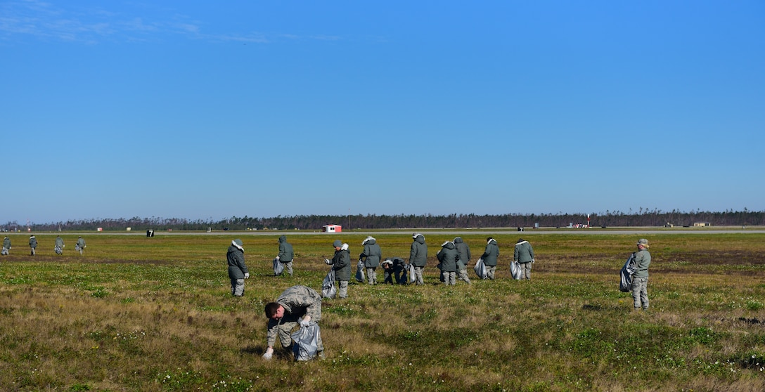 Task Force Talon Airmen clear debris from the areas near the flightline at Tyndall Air Force Base, Fla., Nov. 16, 2018. Members of Task Force Talon are charged with clearing foreign object debris from the Tyndall flightline as well as clearing select dormitories of their contents. (U.S. Air Force photo by Senior Airman Cody R. Miller)