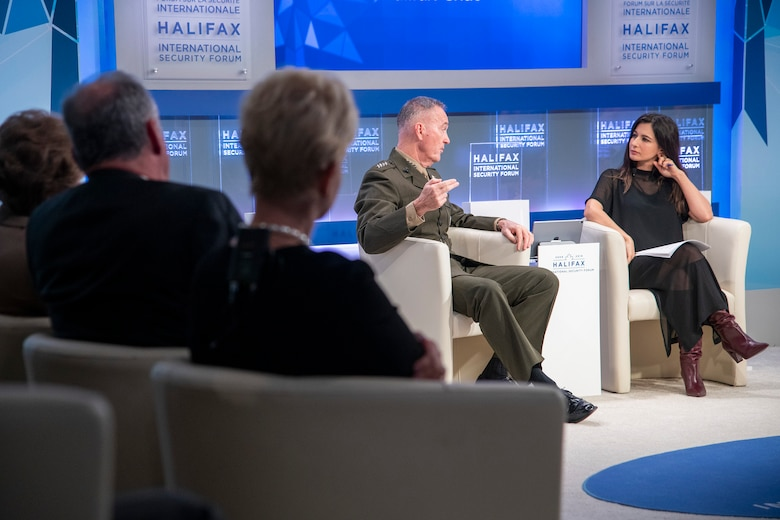 Marine Corps Gen. Joe Dunford, center, chairman of the Joint Chiefs of Staff, is interviewed by BBC World News presenter Yalda Hakim during the Halifax International Security Forum, taking place in Canada.