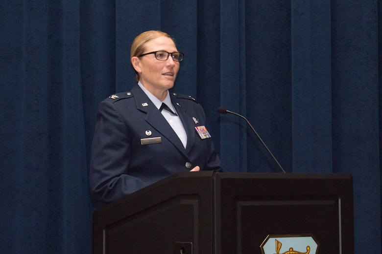 Col. Lori Jones, commander of the newly activated 960th Cyberspace Wing, addresses the crowd of nearly 150 Citizen Airmen at the Inter American Air Forces Academy auditorium at Joint Base San Antonio-Lackland during a ceremony Nov. 18.