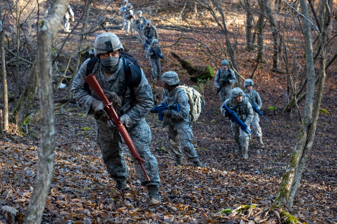 Airmen from the 374th Security Forces Squadron make their way up a hill during a field training exercise at Camp Fuji, Japan, Nov. 8, 2018.