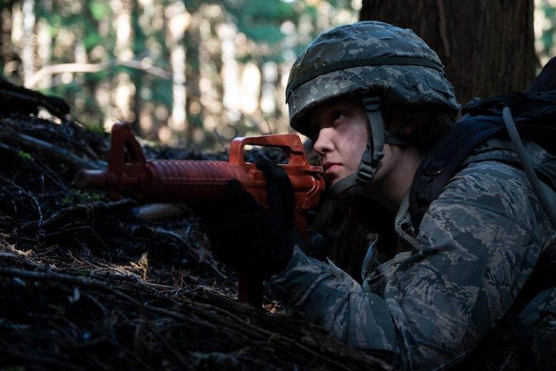 An Airman with the 374th Security Forces Squadron focuses on their area of responsibility for team security during a field training exercise at Yokota Air Base, Japan, Nov. 8, 2018.