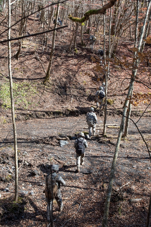 Airmen from the 374th Security Forces Squadron navigate terrain as part of a field training exercise at Camp Fuji, Japan, Nov. 8, 2018.