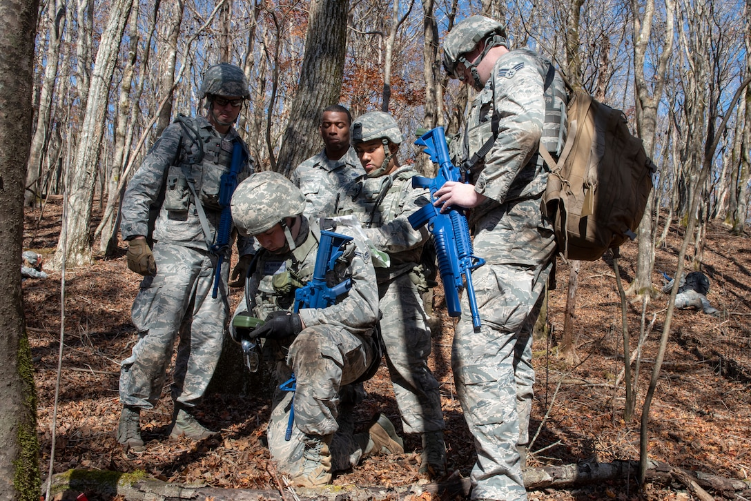 Airmen with the 374th Security Forces Squadron utilize coordinates taken with a Defense Advanced GPS Receiver (DAGR) to plot points on a paper map during a field training exercise at Camp Fuji, Japan, Nov. 8, 2018.
