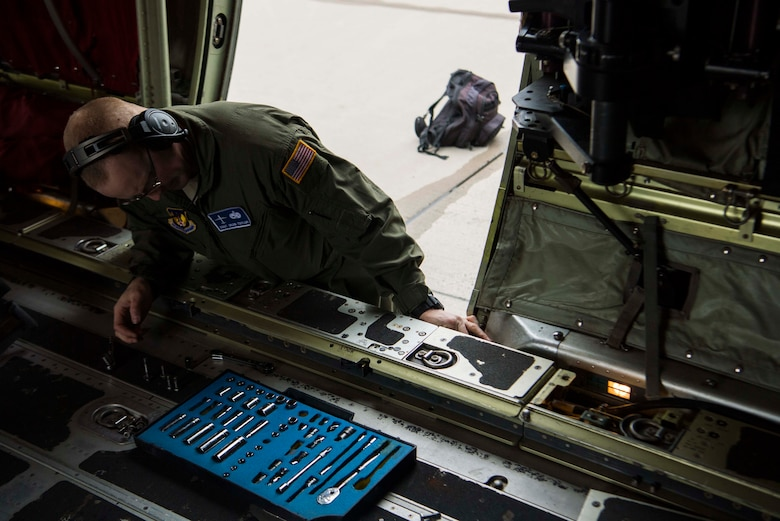 U.S. Air Force Staff Sgt. Sean Taylor, 86th Aircraft Maintenance Squadron flying crew chief works on a C-130J Super Hercules aircraft on Ramstein Air Base, Germany Oct. 31, 2018. Flying crew chiefs ensure the aircraft is taken care of during missions that take place away from home station. (U.S. Air Force photo by Senior Airman Devin M. Rumbaugh)
