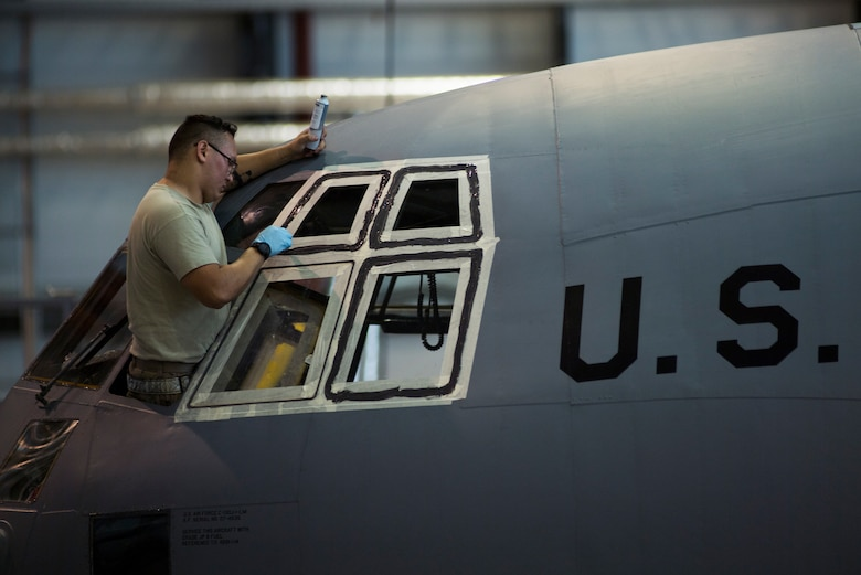 A U.S. Air Force crew chief assigned to the 86th Maintenance Squadron seals a C-130J Super Hercules aircraft window on Ramstein Air Base, Germany, Nov. 6, 2018. Crew chiefs with the 86th MXS ensure aircraft are safe and can be deemed air-worthy. (U.S. Air Force photo by Senior Airman Devin M. Rumbaugh)