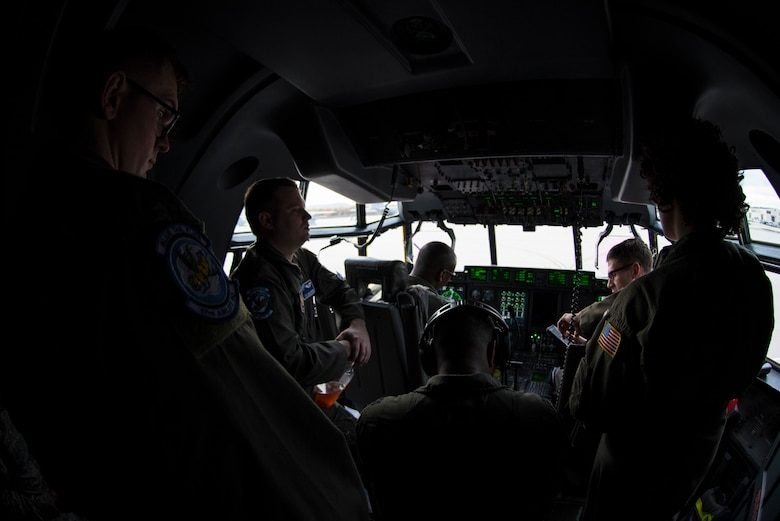 U.S. Airmen assigned to the 37th Airlift Squadron conduct a pre-flight brief on Ramstein Air Base, Germany, Nov. 8, 2018. Pilots and loadmasters work hand in hand to ensure flights are accomplished safely and efficiently. (U.S. Air Force photo by Senior Airman Devin M. Rumbaugh)