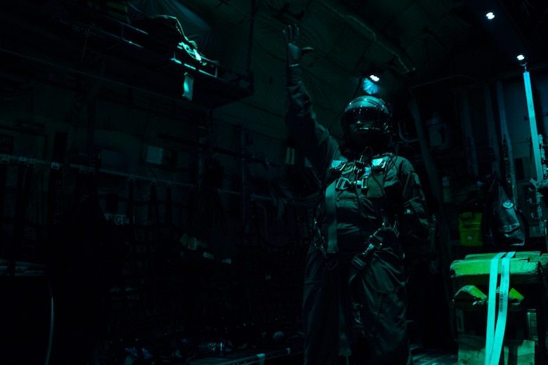 U.S. Air Force Staff Sgt. Crystal Reese, 37th Airlift Squadron C-130J Super Hercules loadmaster, stands ready to conduct a cargo delivery system equipment drop during a nighttime sortie over a drop zone in Germany, Nov. 8, 2018. Reese was responsible for verifying the cargo left the aircraft without issue and at the allotted time. (U.S. Air Force photo by Senior Airman Devin M. Rumbaugh)
