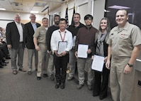 PANAMA CITY, Florida - Commander, Naval Surface Warfare Center (NSWC) Rear Adm. Tom Anderson and Warfare Center Executive Director Don McCormack (SES) present the Joint Expeditionary Command and Control team letters of appreciation Nov. 15, 2018 for their dedication and support to NSWC PCD reconstitution during the aftermath of Hurricane Michael. Recipients are as follows: Jason Calzado, Richard Childress, Jim Nelson, Chiyan Ng, Vinh Tran, Lisa Winsett. U.S. Navy photo by Susan H. Lawson