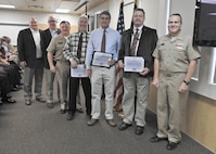 PANAMA CITY, Florida - Commander, Naval Surface Warfare Center (NSWC) Rear Adm. Tom Anderson and Warfare Center Executive Director Don McCormack (SES) present Special Act Awards to three employees Nov. 15, 2018 for their dedication and support during the aftermath and reconstitution of NSWC PCD from Hurricane Michael. Award recipients are as follows: Don McCall, Bill Logsdon, and Kendal Smith. U.S. Navy photo by Susan H. Lawson