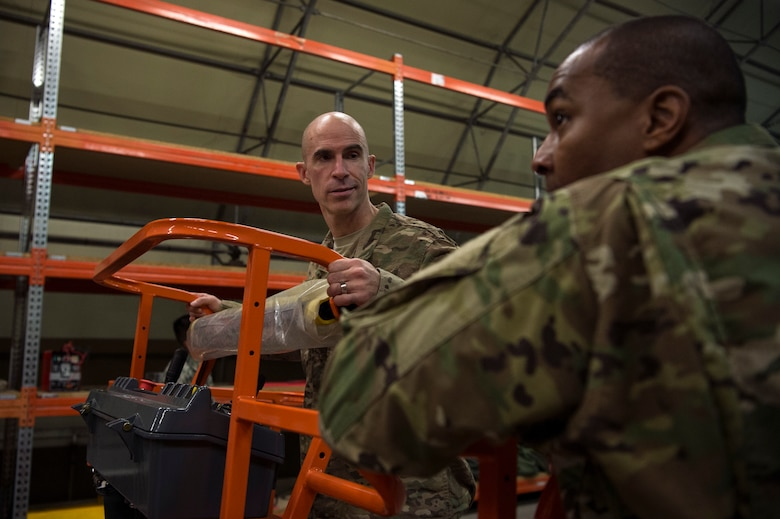 U.S. Air Force Col. Jason Bailey, 52nd Fighter Wing commander, left, and Chief Master Sgt, Alvin Dyer, 52nd FW command chief, right, tour a supply warehouse at Ghedi Air Base, Italy, Nov. 15, 2018. Ghedi is an Italian air force base home to the 6th Stormo Italian air force and U.S Air Force 704th Munitions Support Squadron. Leadership from Spangdahlem Air Base, Germany, visited the 704th MUNSS and toured the complex to get a better understanding of 52nd FW geographically separated unit operations. (U.S. Air Force photo by Airman 1st Class Valerie Seelye)
