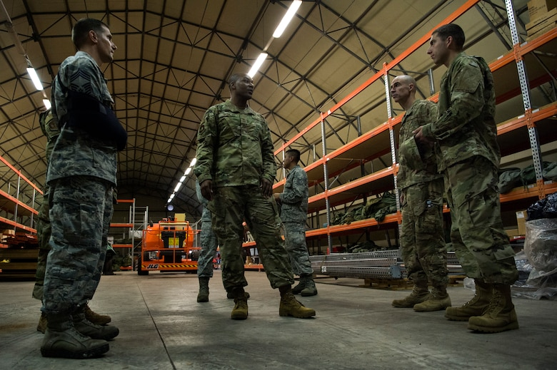 U.S. Air Force Col. Jason Bailey, 52nd Fighter Wing commander, center right, and Chief Master Sgt. Alvin Dyer, 52nd FW command chief, center, tour a supply warehouse at Ghedi Air Base, Italy, Nov. 15, 2018. Spangdahlem Air Base leaders learned how geographically separated Airmen make the mission happen with limited resources. (U.S. Air Force photo by Airman 1st Class Valerie Seelye)