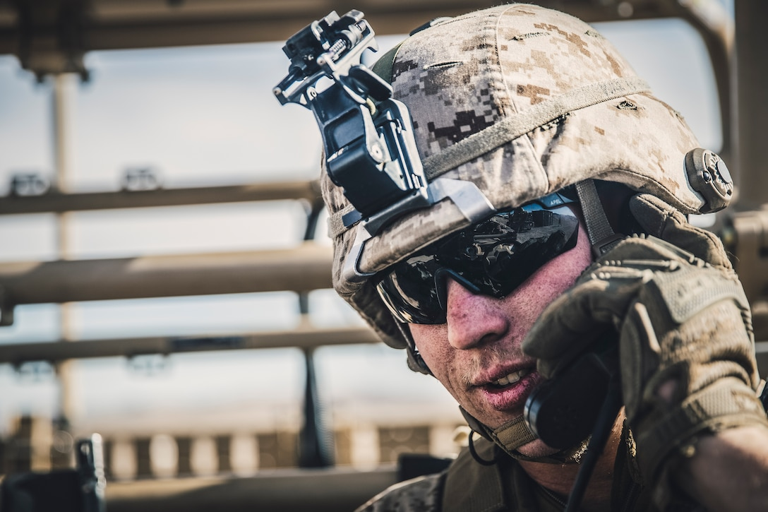 Lance Cpl. Andrew Tocko, a low altitude air defense gunner with Marine Medium Tiltrotor Squadron 163,11th Marine Expeditionary Unit, operates a radio from a Light Marine Air Defense Integrated System at Marine Corps Air Ground Combat Center Twentynine Palms, Calif., Nov. 13, 2018. The VMM-163 Marines supported Battalion Landing Team 3rd Battalion, 5th Marine Regiment's operations at the combat center, employing the LMADIS to defeat unmanned aircraft systems via electronic attack.