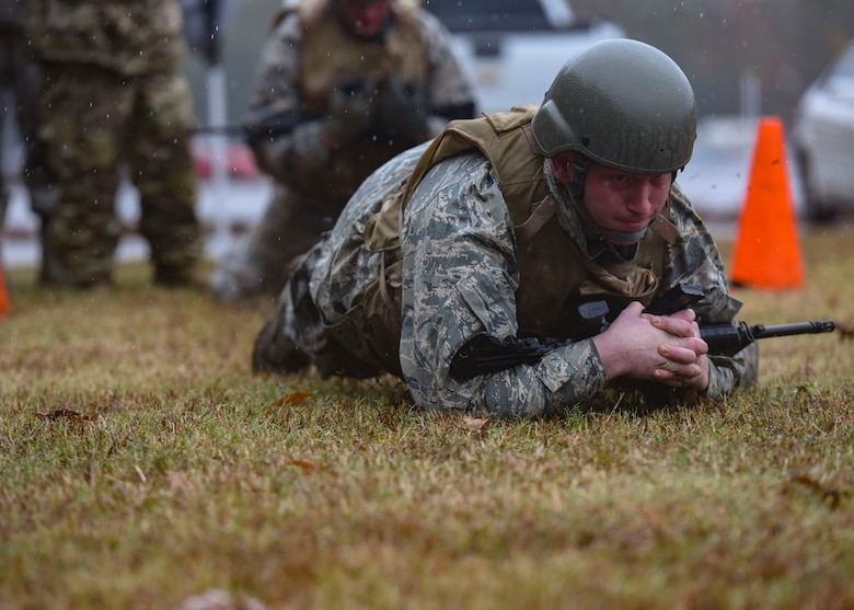 U.S. Air Force Senior Airman Cody Smitherman, 633rd Civil Engineer Squadron electrical systems apprentice, crawls with his weapon during Prime Base Engineer Emergency Force training at Joint Base Langley-Eustis, Virginia, Nov. 15, 2018.