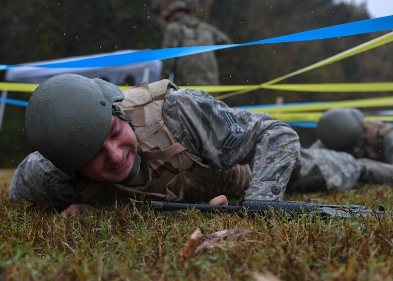 U.S. Air Force Senior Airman Brandon Ambrose, 633rd Civil Engineer Squadron electrical systems journeyman, performs a low crawl during Prime Base Engineer Emergency Force training at Joint Base Langley-Eustis, Virginia, Nov. 15, 2018.