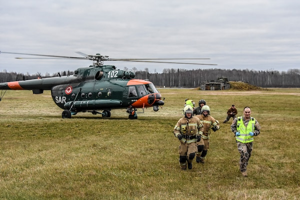 Members of the National Armed Forces of Latvia combined with Airmen from the 110th Attack Wing, Battle Creek Air National Guard Base, Mich., 127th Wing, Selfridge ANG Base, Mich., and Alpena Combat Readiness Training Center, Mich., in an emergency response drill at Lielvārde Air Base, Latvia, Nov. 16, 2018.
