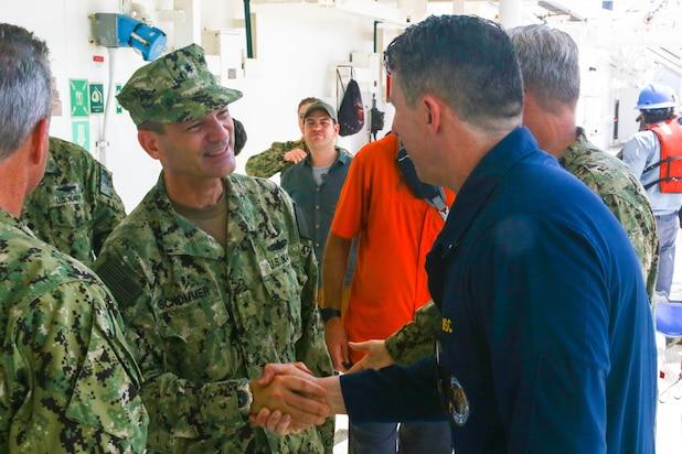 Rear Adm. John Schommer, deputy commander, U.S. 4th Fleet, arrives aboard the hospital ship USNS Comfort (T-AH 20) and meets with Merchant Marine Capt. David Murrin, ship's master, Comfort.