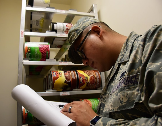Senior Airman Daniel Gonzalez Hernandez, a services journeyman with the 118th Force Support Squadron, checks inventory in the storeroom on October 14, 2018 at Berry Field Air National Guard Base, Nashville, Tennessee.