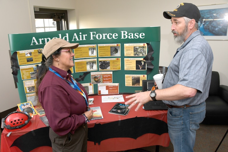 Leslie Hay, U.S. Fish and Wildlife Service liaison at Arnold Air Force Base, shares information with Arnold team members during International Bat Week by setting up a display at Café 100 in the Administration and Engineering Building on Oct. 31. Pictured is Hay, left, speaking with Troy Smiddy. (U.S. Air Force photo by Rick Goodfriend)
