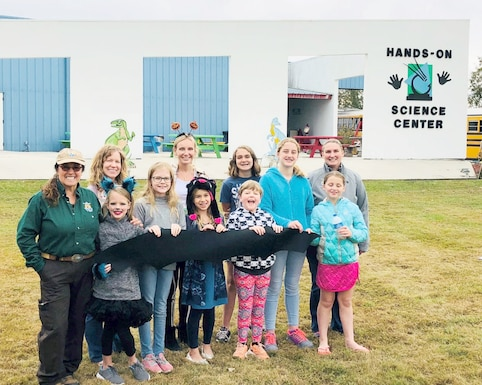 """Leslie Hay, a U.S. Fish and Wildlife Service biologist at Arnold, along with Sarah Harrison, USFWS Tennessee Field Office biologist, and Shannon Allen, chief of National Environmental Policy Act, Natural and Cultural Resources, join Arnold Science, Technology, Engineering and Mathematics director Olga Oakley to provide a """"Celebration of Bats"""" to a group of homeschooled students recently visiting the Hands-On Science Center. This presentation was part of an outreach effort during the 2018 International Bat Week. (Courtesy photo)"""
