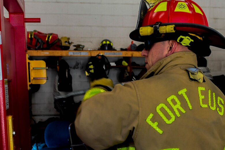 Marco Netzer, Fort Eustis Fire Department lieutenant, conducts refresher training with the Wide-ADZ Pro Bar to forcibly open a door at the Newport News Fire Department in Newport News, Virginia, Nov. 16, 2018. Forced entry is used by firefighters to gain access to a building that is caught on fire or to rescue someone who is trapped. (U.S. Air Force photo by Senior Airman Derek Seifert)