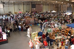 Shoppers at the 38th annual Santa's Market explore the 78 booths at the Louis F. Garland Department of Defense Fire Academy on Goodfellow Air Force Base, Texas, Nov. 17, 2018. This year, there were many local vendors set up to show off a variety of items. (U.S. Air Force photo by Airman 1st Class Seraiah Hines/Released)