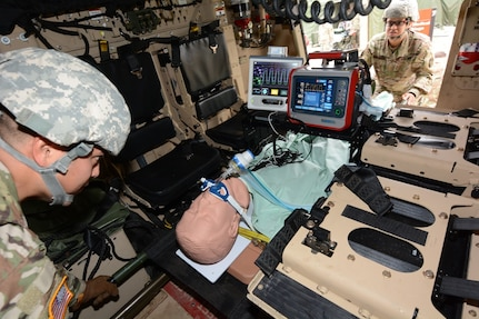 Soldiers testing the intrathoracic pressure regulation therapy, or IPRT, device load it onto a Mine-Resistant Ambush Protected, or MRAP, vehicle Nov. 7 at Joint Base San Antonio-Camp Bullis.
