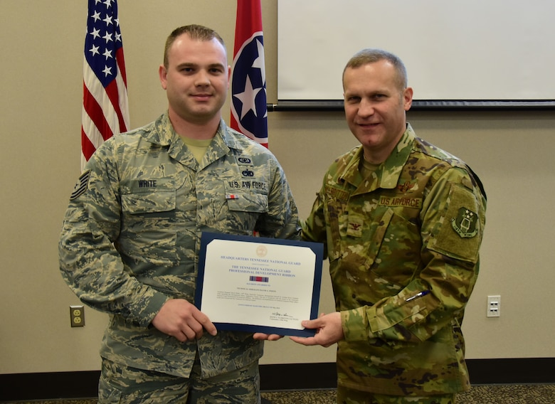 U.S. Air National Guard Tech. Sgt. David White, an occupational safety Airman with the 118th Wing Safety Office, is awarded the professional development ribbon by Col. Keith Allbritten, commander of the 118th Wing, on Nov. 3, 2018 at Berry Field Air National Guard Base, Nashville, Tennessee.