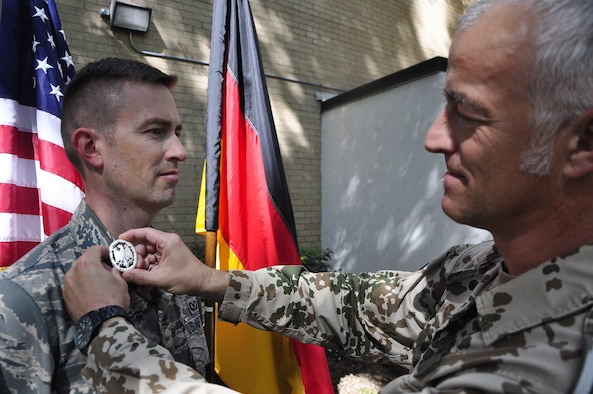 Maj George Chapman, Air Command and Staff College student, receives a German Armed Forces Proficiency Badge from German liaison officer SgtMaj Michael Kern at Maxwell's Air War College on May 4th