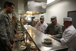 Col. Adam Willis, 445th Airlift Wing commander, Chief Master Sgt. Paul Stewart, 445th command chief and Lt. Col. Todd Reeder, 445th Maintenance Squadron, serve holiday meals to 445th AW Airmen at the Pitsenbarger Dining Facility Nov. 4, 2018. Each year, commanders, chiefs and first sergeants serve meals to Airmen during the November and December unit training assemblies.