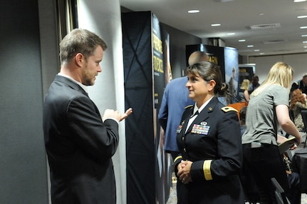 Paul Kelly, left, principal of Elk Grove High School and the 2018 Illinois Principal of the Year meets Brig. Gen. Kris A. Belanger, commanding general of the 85th United States Army Reserve Support Command, during a reception, ahead of the 2018 U.S. Army Leadership Symposium held at Fort Leavenworth, Kansas, November 7-9, 2018.