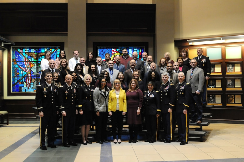 Principals, counselors and educators from around the nation pause for a photo with U.S. Army Soldiers and staff members during the 2018 U.S. Army Leadership Symposium held at Fort Leavenworth, Kansas, November 7-9, 2018.