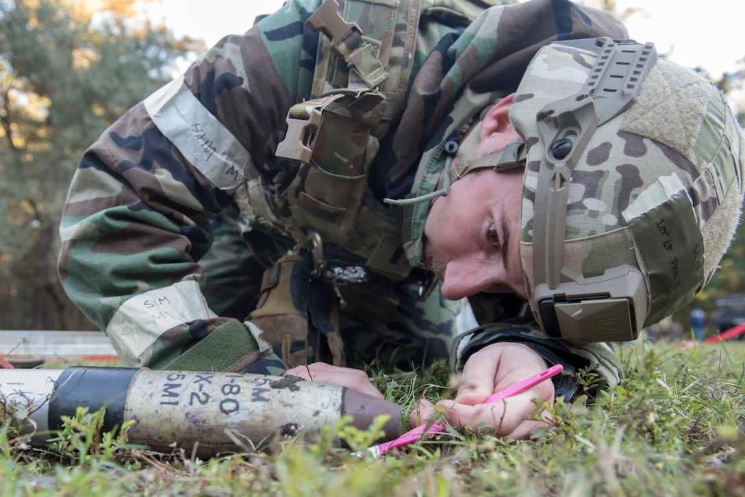 1st Lt. Paul Underwood, 628th Civil Engineer Squadron explosive ordnance disposal flight commander, inspects an unexploded ordnance during an exercise Nov. 16, 2018 at Joint Base Charleston, S.C.To keep the training as realistic as possible, participants from across JB Charleston received the equipment, weapons and specialty uniform items they would use in real-world situations. The simulated scenarios enabled senior base leaders and subject matter experts to ensure the readiness of JB Charleston's quick response capabilities.
