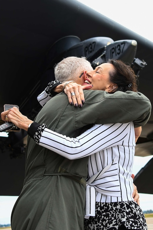 U.S. Air Force Lt. Col. Dwayne Slack, 307th Maintenance Group deputy commander, hugs his wife, Cathi, after completing a flight aboard a B-52 Stratofortress at Barksdale Air Force Base, Louisiana, Jan. 24, 2018.  Slack has served as a Reserve Citizen Airman for more than 30 years, originally enlisting in 1988. (U.S. Air Force photo by Master Sgt. Ted Daigle)
