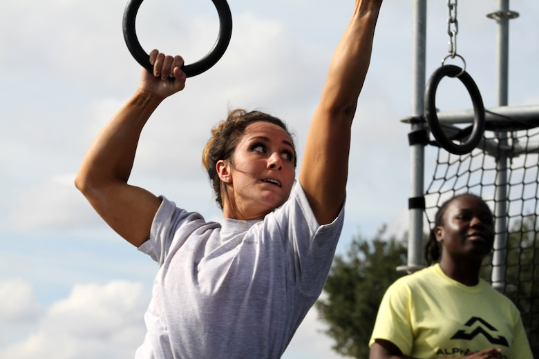 Air Force Senior Airman Stephanie Williams tackles the rings obstacle of the proving rig during the first Inter-service Alpha Warrior Final Battle Nov. 17, 2018, Retama Park, Selma, Texas. (U.S. Air Force photo by Debbie Aragon)