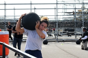 Air Force Senior Airman Stephanie Williams carries a medicine ball during one of the strength stations of the proving rig during the first Inter-service Alpha Warrior Final Battle Nov. 17, 2018, Retama Park, Selma, Texas. (U.S. Air Force photo by Debbie Aragon)