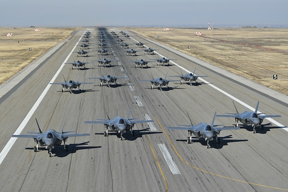 Pilots from the 388th and 419th Fighter Wings taxi F-35As on the runway in preparation for a combat power exercise Nov. 19, 2018, at Hill Air Force Base, Utah. During the exersice, the wings confirmed their ability to employ a large force of jets against air and ground targets, demonstrating the readiness and lethality of the F-35 Lightning II. As the first combat-ready F-35 units in the Air Force, the 388th and 419th FWs are ready to deploy anywhere in the world at a moment's notice. (U.S. Air Force Photo By Cynthia Griggs)