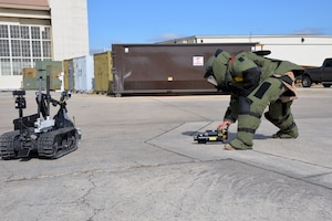 Tech. Sgt. James M. Gonzales, 433rd Civil Engineer Squadron explosive ordnance disposal specialist, sets up a portable X-ray system to inspect a suspicious package held by a Talon explosive ordnance disposal robot during a wing-wide readiness exercise at Joint Base San Antonio-Lackland, Texas Nov. 17, 2018.