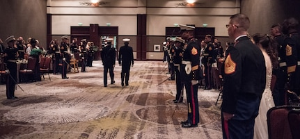 Team Charleston Marines and guests await the arrival of the official party at the annual Marine Corps' Ball at the Charleston Area Convention Center Nov. 17, 2018, in Charleston, S.C. Retired Marine Corps Col. Arthur Sass, a naval science instructor at Eau Claire High School, delivered the keynote address during the ceremony celebrating the service's 243rd birthday. The Marine Corps was established on Nov. 10, 1775 and its birthday is celebrated with a traditional ball and cake-cutting ceremony.