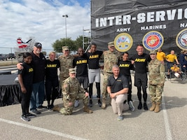 Air Force Installation and Mission Support Center Commander Maj. Gen. Brad Spacy poses for a photo with members of the Army team following the first Inter-service Alpha Warrior Final Battle Nov. 17, 2018. The competition was held at Retama Park, Selma, Texas, and featured teams from the Air Force, Navy and Army. The Army team came in second behind the Air Force. (U.S. Air Force photo by Debbie Aragon)