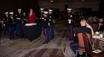 Marines await the beginning of the cake-cutting ceremony at the  Marine Corps' Ball held at the Charleston Area Convention Center Nov. 17, 2018, in Charleston, S.C. Retired Marine Corps Col. Arthur Sass, now a naval science instructor at Eau Claire High School, delivered the keynote address during the ceremony. The Marine Corps was established on Nov. 10, 1775 and its birthday is celebrated with a traditional ball and cake-cutting ceremony.