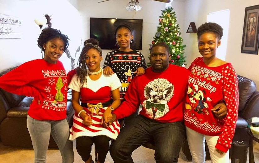 Family poses for Christmas photo.