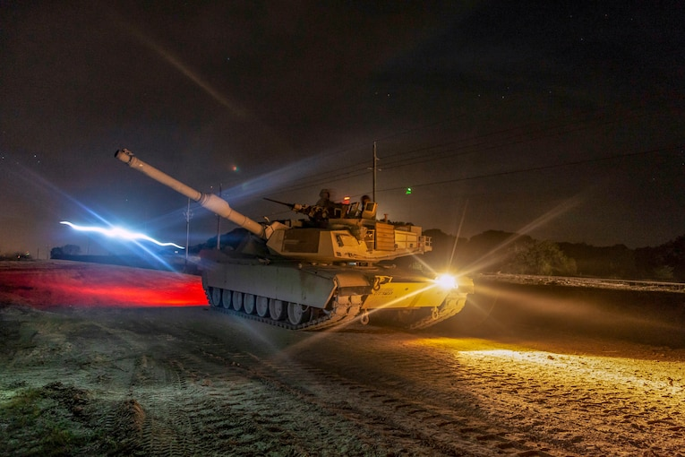 A tank participates in night time training  in Poland.