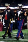 Brig. Gen. Bradley S. James, left, commander of Marine Forces Reserve and Marine Forces North, and Sgt. Maj. Ronald L. Green, sergeant major of the Marine Corps, are escorted onto the field during the 243rd annual Marine Corps birthday ball at the Mercedes-Benz Superdome, New Orleans, on Nov. 16, 2018. Every year, a birthday ball is hosted celebrating the birthday and traditions of the Marine Corps. (U.S. Marine Corps photo by Lance Cpl. Tessa D. Watts)Brig. Gen. Bradley S. James, left, commander of Marine Forces Reserve and Marine Forces North, and Sgt. Maj. Ronald L. Green, sergeant major of the Marine Corps, are escorted onto the field during the 243rd annual Marine Corps birthday ball at the Mercedes-Benz Superdome, New Orleans, on Nov. 16, 2018. Every year, a birthday ball is hosted celebrating the birthday and traditions of the Marine Corps. (U.S. Marine Corps photo by Lance Cpl. Tessa D. Watts)