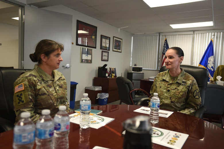 Brig. Gen. Kris A. Belanger, left, commanding general of the 85th United States Army Reserve Support Command, meets with Lt. Col. Jennifer Nolan, Garrison Commander, Parks Reserve Forces Training Area, to receive an operational overview, Nov. 16, 2018.
