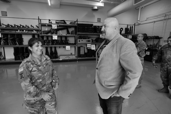Brig. Gen. Kris A. Belanger, commanding general of the 85th United States Army Reserve Support Command, meets with Scott Mitten, who oversees the TADS (training aids, devices and simulators) warehouse at Parks Reserve Forces Training Area, Nov. 16, 2018.