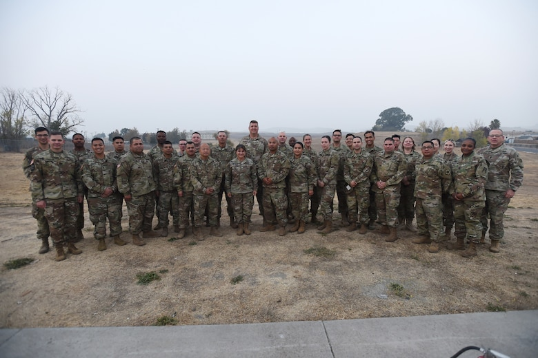 Brig. Gen. Kris A. Belanger, center, commanding general of the 85th United States Army Reserve Support Command, pauses for a photo with Army Reserve Soldiers assigned to the 2-360th Training Support Battalion, 85th Support Command, at Parks Reserve Forces Training Area, Nov. 17, 2018.