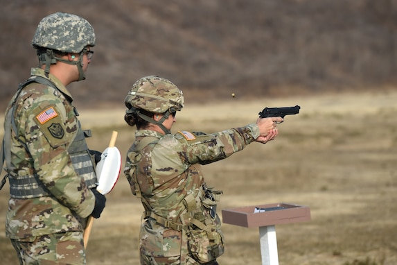 Brig. Gen. Kris A. Belanger, commanding general of the 85th United States Army Reserve Support Command, fires an M9 pistol during a range qualification at Camp Parks, California, Nov. 17, 2018.